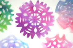 Gorgeous coffee filter snowflakes made by toddlers and preschoolers. - Happy Hooligans