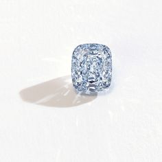 The 6.01 Fancy Vivid Blue Diamond that sold for 10.1 million USD, or 1,686,505 USD per carat, at Sotheby's Hong Kong in October 2011. While round brilliants continue to be the preferred cut for colorless diamonds, the shape is exceptionally rare in colored diamonds due to the high wastage of diamond rough.  Typically, a diamond rough of at least double its fashioned carat weight is required to fashion a diamond into this popular and desirable shape.