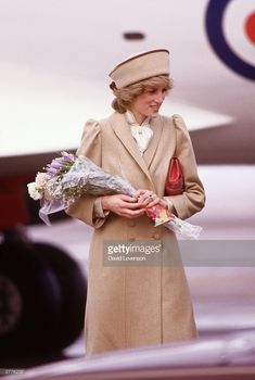 Diana Princess of Wales arrives at East Midlands airport on February 19, 1985 for a visit to Derby. She wore a coat designed by Caroline Charles. (Photo by David Levenson/Getty Images)