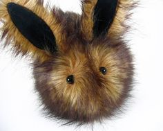 Cute Rusty Bunny Faux Fur Plushie Wide eyed with furry velvet ears and a cute cottontail, Cute Rusty bunny would make a great office pet or warm fuzzy snuggly. $35