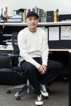 Eugene Tong's Casual Men's Work Style, featuring a Phigvel Sweatshirt, Second/Layer Pants, and Comme des Garçons sneakers. // More Creative Work Style Ideas from the Details Offices: (http://www.racked.com/2015/11/11/9677512/details-magazine-new-york-office)