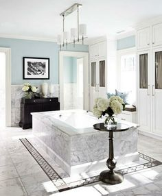 """""""Padallian Blue"""" walls set off the stunning marble tub in this designer's home. - Traditional Home ®/ Photo: Colleen Duffley / Design: Bob Williams"""