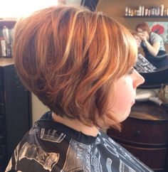 Copper red bob with scattered blonde highlights. Using a curling iron on shorter hair is fun if you get bored of the flat ironed look!