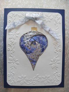 silver & blue iris folding ornament                                                                                                                                                                                 More