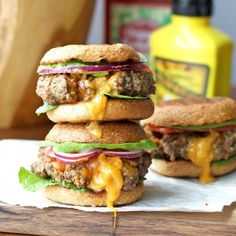 Juicy hamburger sliders stuffed with cheddar and bacon topped with lettuce, tomato, red onion, and avocado- yum!