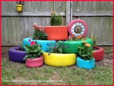 color tires in different colors and you'll obtain a lot of pots for your flowers, and make a gorgeous rainbow in the garden!