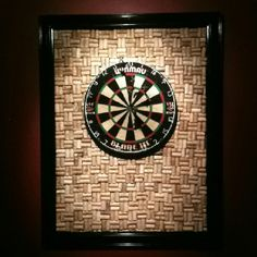 Wine cork dartboard backboard.... I want something like this around our dartboard cabinet!
