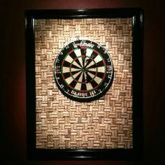 Wine cork dartboard backboard.... I want something like this around our dartboard cabinet!