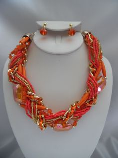 Visit: hipandcoolcliponearringstwo.com and receive up to 30% off. CLIP ON EARRING ORANGE & GOLD SEED BEAD NECKLACE SET  $16.99 http://hipandcoolcliponearringstwo.com