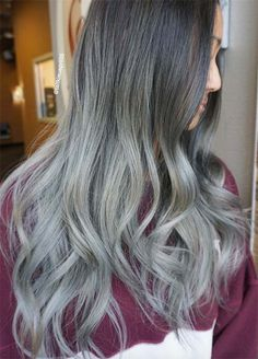 Long Ombre Grey Hair  Long ombre hair is clearly popular and the reasons why are so evident – it is gorgeous. Every combination of ombre has its own appeal. In this case the silver really picks up towards the middle of the full length and the transition between the slate and silver colors is beautiful.