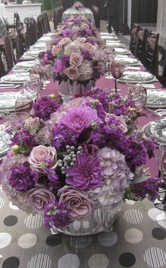 Pretty purple, violet, lilac, and lavender reception table centerpieces.