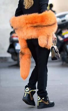 Most Over-The-Top Sneaker Styling If you're going to wear Riccardo Tisci for Nike kicks, you naturally have to pair them with a massive orange fur stole and a crocodile bag.  Photo: Youngjun Koo/I'M KOO