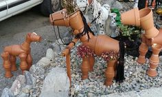 Working on many more clay flower pot horses.