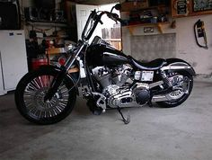 2002 DYNA WIDE GLIDE--12000.00 DOLLARS OBO REBUILT 96 MOTOR WITH LESS THAN 2000 MILES--NEW MICHELIN TIRES--NEW KING SPOKES--600 LIFT HIGH PERFORMANCE HEADS DIAMOND CUT BY BILL CHAMBERS RACING--CUSTOM