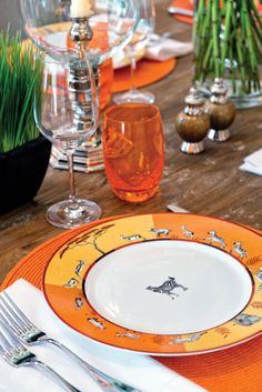 Orange Hermès Africa dinnerware in the Palm Beach home of Ross Meltzer and Victor Figueredo. Photo by Jerry Rabinowitz.