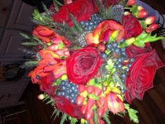 Autumn berry bouquet with Grand Prix roses and orange freesia