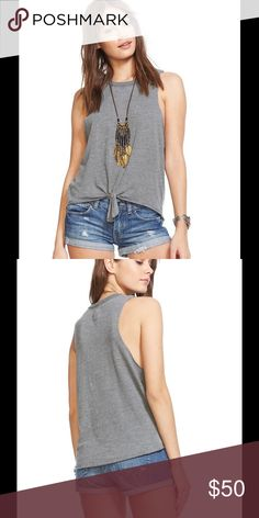 Chaser Tie Front Muscle Tank Gray Chaser has created your perfect triblend muscle tank! This tie front muscle tank is exactly what you've been looking for with the perfect fit and super soft fabric!  Fabric Content: 50% POLYESTER 38% COTTON 12% RAYON  Imported  Model is Five Foot Nine and wearing a size Medium Chaser Tops Tank Tops