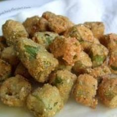 "Southern Fried Okra ---   Cut off okra stem ends and tips and slice crosswise into rounds 1/4"" thick. Pat dry on paper towel. Dip rounds in flour, then into egg, and then roll in corn meal to coat evenly. Set on paper toweling. Heat butter in a large, heavy skillet 1 minute over moderate heat. Add okra and sauté about 2 minutes on a side until golden brown. Drain on paper towel, sprinkle with salt and pepper."