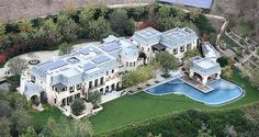 tombrady---This beauty was purchased by Tom Brady and Gisele Bundchen for just a mere 22 million dollars.  The house is located in a swanky area of Los Angles.  According to Huff Post it is 22,000 square feet and has 8 bedrooms, 6 car garage, pool, spa, weight room and wine cellar.