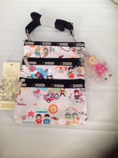 NWT Disney LeSportsac it's a Small World Around the World Kasey Bag w charm  #Lesportsac