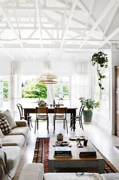 this is what happens when talented ceramicist alison fraser and her husband andrew move from sydney out to the australian countryside — magic! they've got the exposed ceilings and rafters that i dream about going on, creating such an open, airy and yet still cozy space. all that natural light flooding in through the beautiful …
