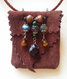 This leather medicine bag was handmade by me in my studio in upstate NY. The leather was taken from an old leather coat. The gemstones surround the theme of protection. The stones are labradorite, tigers eye, malachite, and rutilated quartz.