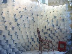 In the shop window at Anthroplogie this weekend, we spied this shelter made of, well, reused plastic milk jugs...