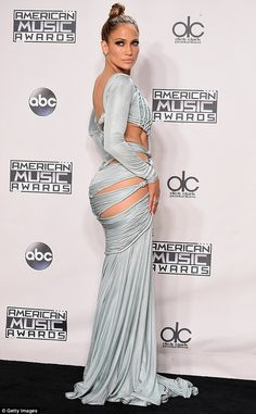 Jennifer Lopez Stuns In 10 Sexy Outfits To Host The 2015 American Music Awards Jennifer Lopez Age, Jennifer Lopez Bikini, Jennifer Lopez Photos, Sexy Outfits, Robes Glamour, Then And Now Photos, Blue Gown, American Music Awards, Beauty News