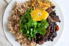 "Vegan Brazilian Feijoada (Black Bean Stew) is so delicious and so filling! Plus it's such a ""meaty"" dish, so it's a perfect dish for anyone really! www.sprinkleofgreen.com"