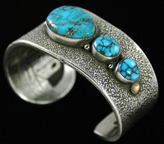 Sammie Kescoli Begay RARE Gem Grade Candelaria Spiderweb Turquoise Bracelet | eBay Navajo jeweler Sammie Kescoli Begay has created this stunning tufacast bracelet by selecting three rare gem grade natural Candelaria turquoise cabochons to offset down the side of the tapered sterling shank. The gems are a deep blue characteristic of the highest grade from this now depleted mine. Each stone has chocolate and reddish-brown spiderweb matrix. $1695