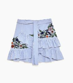 Ruffled miniskirts are back with a vengeance for spring—and this editor is on the fence about the throwback trend.