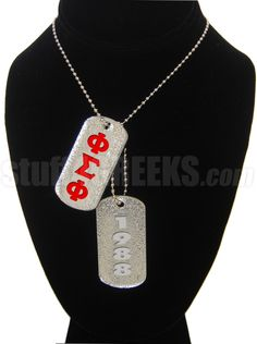 Phi Sigma Phi dog tags. Shiny double-sided acrylic dog tags with the Greek letters on one side and the founding year on the other.
