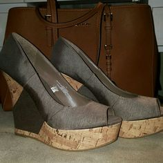 Mossimo cork wedges Taupe and cork colored wedges. Very high and youll need a good arch in your feet to wear. Minimal wear Mossimo Supply Co Shoes Wedges