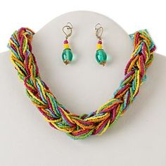 multi-strand, gold-finished steel and brass with glass, multicolored, 18-inch braid with 2-inch extender chain and lobster claw clasp, 2-inch earrings --love the colors!