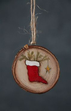 Red Stocking with Star Wood Slice Ornament - Individually painted by hand without the use of patterns or stencils, my wood slice ornaments are a truly unique gift, perfect for a personalization, commemorating a special event, for Christmas, weddings, baby showers, birthdays, or any special occasion! Each comes gift boxed, and includes free personalization on the back!  DESIGN - Red stocking with white cuff, stuffed with pine sprigs, with a single tiny hanging gold star. Background is a light…