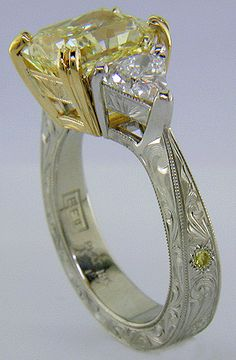 Yellow radiant-cut diamond with trilliant diamonds in a custom platinum ring.