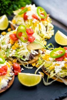 Tostadas are an easy, Mexican inspired recipe perfect for feeding the entire family any night of the week. Crispy, crunchy corn tortillas topped with creamy homemade refried beans, cheese, zesty salsa, avocado and shredded lettuce , our recipe is packed with the classic flavors and textures for a mouthwatering meal! And since you can customize them as much as you want, you know everyone will end the meal full and happy! Tostada Recipes, Dip Recipes, Veggie Fajitas, Homemade Refried Beans, Frozen Corn, Corn Tortillas, Tostadas, Monterey Jack Cheese, Meals
