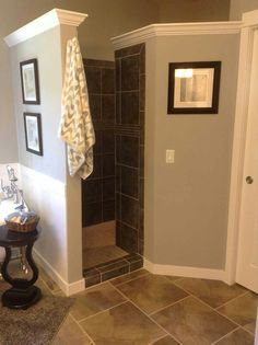 Walk in shower...no door to clean! I would definitely have it so you walk around the corner to the shower