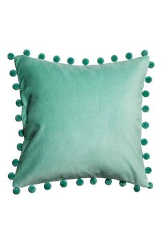 Cushion cover with pompom trim: Cushion cover in velvet with a pompom trim and concealed zip.