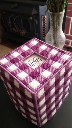 Purple checkered tissue box cover. Handmade with deep purple, medium purple, and white yarn. Comes with a boutique tissue box. Fashioned in a smoke free, pet free home. This is already made by hand and ready to ship. Combined shipping is always offered