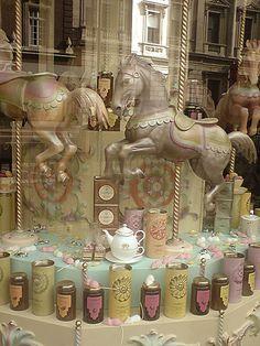 Carousel Horses & Teatime goods window display at Fortnum & Mason in London