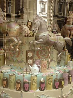Carousel Horses & Teatime goods window display at Fortnum & Mason in London
