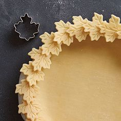 6. Falling Leaves You'll fall in love with this design! Lay dough on a Pastry Mat and cut out about 24 leaves with the leaf Creative Cutter. You can use the releasing end of the Cake Tester & Releaser to create the design detail on the leaves. Press your crust into a pie pan and line the rim with the cutouts, attaching with egg wash or a bit of water. Brush with egg wash before baking to enhance the leaf detail.  Tool to use: Creative Cutter Set