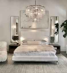 Luxury All White Bedroom Decor Luxury bedroom with white bed, white walls, chrome assents, crystal chandaleer, and sheepskin blanket Luxury Bedroom Design, Master Bedroom Design, Bedroom Designs, Master Suite, Master Bedrooms, Romantic Bedroom Design, Simple Bedroom Design, Luxury Home Decor, White Bedroom Decor