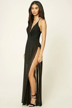 A knit maxi dress featuring a surplice neckline, a strappy scoop back, semi-sheer faux wrap skirt, and a ruched waist.