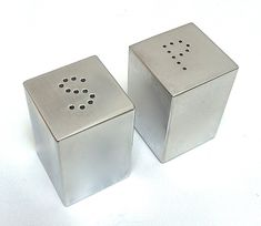 "Salt Pepper Shakers, Aluminum Charles Sheeler (1883-1965) U.S.A 1935 H 1.5"" W 1"" D 1"""
