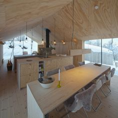 No frills, no fluff, Reiulf Ramstad Arkitekter's V-Lodge is a minimal, all-year cabin in the mountains of Norway. The cabin was specifically built to adapt to the topography of the site with simple V shape. Plywood Interior, Plywood Walls, Plywood Sheets, Secluded Cabin, Timber Cabin, Casas Containers, Interior Architecture, Interior Design, Cuisines Design