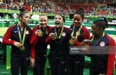 (L to R) Gold medalists Alexandra Raisman, Madison Kocian, Lauren Hernandez, Gabrielle Douglas and Simone Biles of the United States pose for photographs with their medals after the medal ceremony for the Artistic Gymnastics Women's Team on Day 4 of the Rio 2016 Olympic Games at the Rio Olympic Arena on August 9, 2016 in Rio de Janeiro, Brazil.  (Photo by Lars Baron/Getty Images)