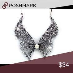 """White pearl floral lacework collar tied with a bow Pretty white pearl beads dot the silvertone floral lacework of this designer-style 18"""" adjustable 2"""" wide collar necklace """"tied"""" with a bow. Jewelry Necklaces"""