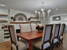 As seen on HGTV's Fixer Upper, this dining room melds modern touches with rustic detail for a beautiful and inviting space.